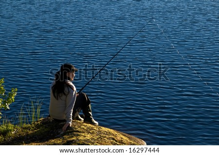 fishing in a calm summer lake in the north of Sweden - stock photo