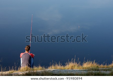 fishing in a fjord - stock photo