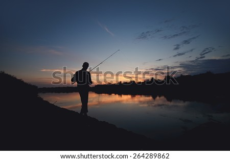 fishing in the lake - stock photo