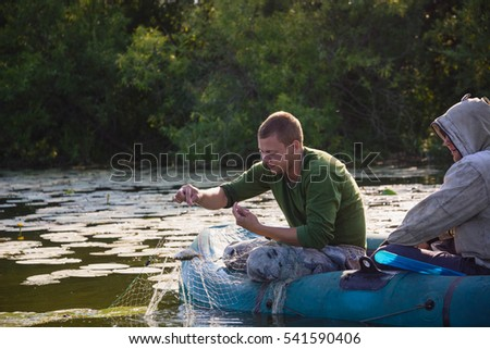 Fishing in the summer in the boat in network