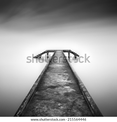 Fishing jetty in black and white ( slightly motion blur ) - stock photo