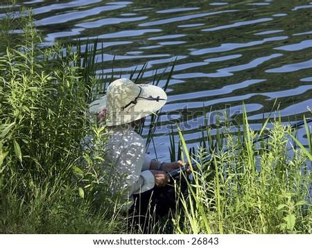 Fishing Lady - stock photo