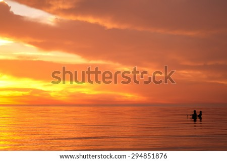 fishing man silhouette on sunset, natural summer background - stock photo