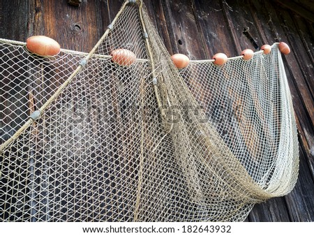 fishing net at an old port - stock photo