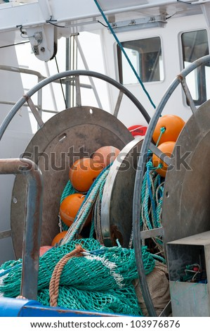 Fishing net on a winch on a fishing boat. The photo illustrates the fishery in the widest sense. - stock photo