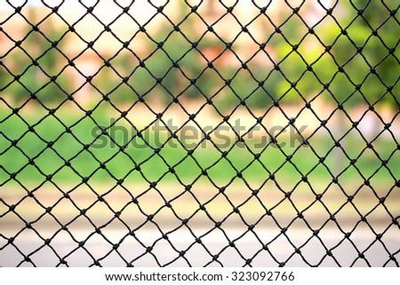 Fishing net on public park background. - stock photo