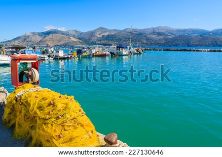 FIshing net with boats in Greek port of Lixouri town, Kefalonia island, Greece  - stock photo