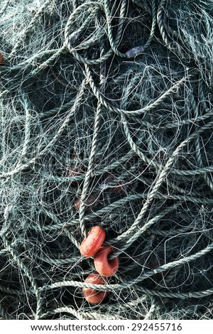 Fishing Net with Ropes and Floats - stock photo