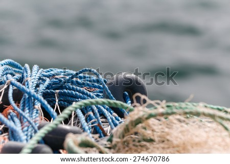 Fishing nets and floats with sea background. - stock photo