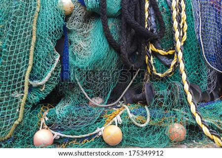 Fishing nets collected at fishing village - stock photo