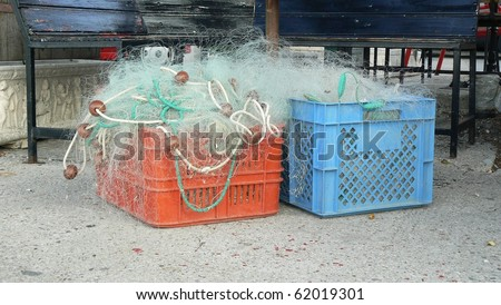 Fishing nets in a red and blue box - stock photo