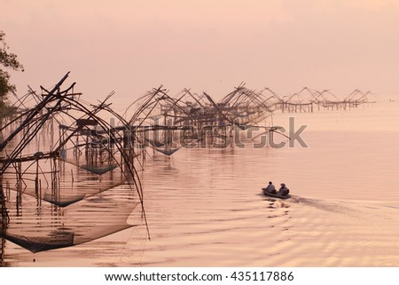 Fishing nets in the lake in Southern part of Thailand in warm morning light - stock photo
