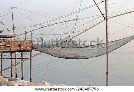 fishing nets on stilts over the sea