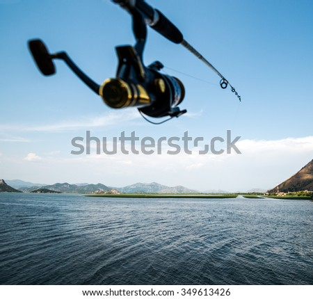fishing on the lake at the weekend - stock photo
