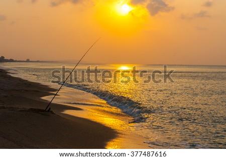 Fishing on the Sunset - stock photo