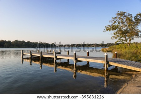 Fishing pier and boat launch in Bayview Park on Bayou Texar in Pensacola, Florida in early morning light - stock photo