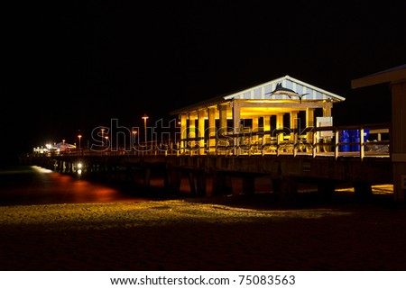 Fishing pier at night in Lauderdale By The Sea