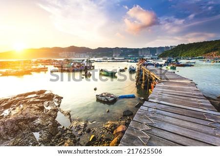 Fishing pier bridge at sunset - stock photo