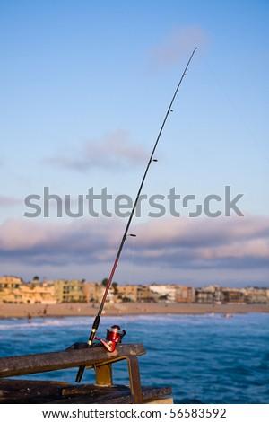 Fishing Pole at Sunset on the Venice Beach Pier. - stock photo