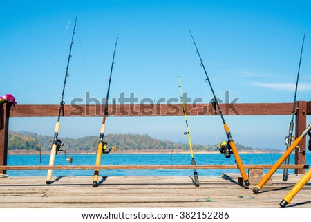 Fishing Poles with River Background - stock photo