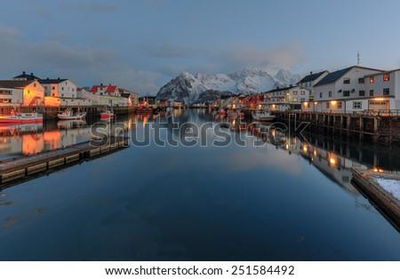 Fishing port in a small Norwegian village at sunrise - Henningsvaer, Lofoten islands, Norway - stock photo