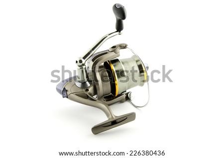 fishing reel isolated on white background - stock photo