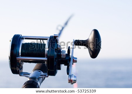 Fishing rod and horizont of sea - stock photo