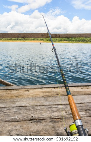 fishing rod ,spinner for fishing (fishing bob) on river natural