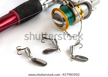 fishing rod spinning hooks spinner bait tackle fishing line spool on a white background isolation - stock photo