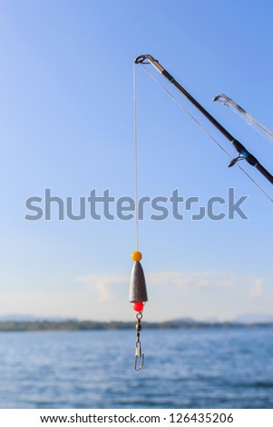 Fishing rods at the ready with blue sky. - stock photo