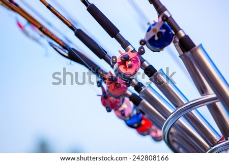Fishing rods on boat close-up. - stock photo