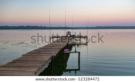 Fishing rods on pier in the morning, Volga, Russia