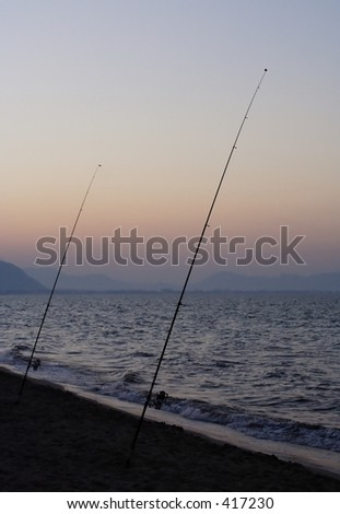 Fishing rods on the beach at sunset...