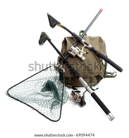Fishing rods with reels and landing net with a back-pack. - stock photo