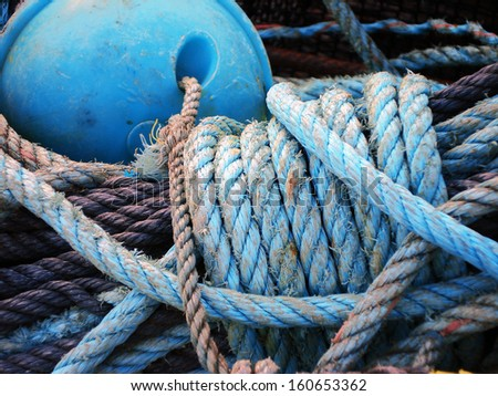 fishing rope with cork and sailor knot - stock photo