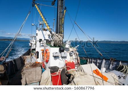 Fishing ship at sea in the fishing area. - stock photo