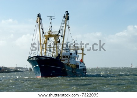 fishing ship during a storm in harbor - stock photo