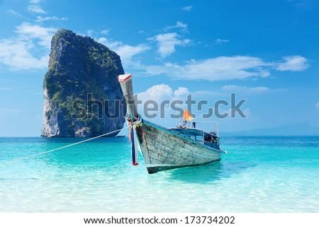Fishing thai boat and landmark at Poda island, Krabi Province, Andaman Sea, South of Thailand  - stock photo