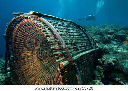 Fishing trap and diver - stock photo