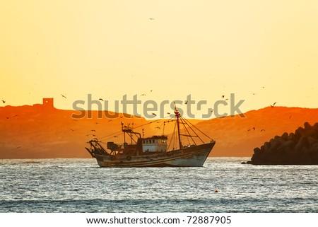 Fishing trawler in sunset light, Essaouira, Morocco, Africa - stock photo