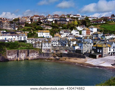 Fishing village; Beautiful traditional Cornish fishing village with harbor in foreground; good copy space  - stock photo