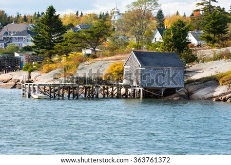Fishing Village with Fall Colors in Maine - stock photo