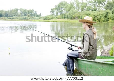 fishing woman sitting on boat