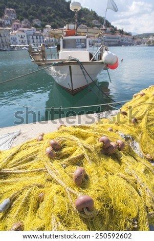 Fishnets on fish boat. Yellow net. Greece, Gythio - stock photo