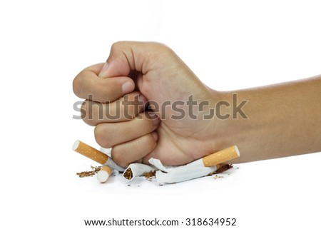 fist breaking cigarette stop smoking concept on white background - stock photo