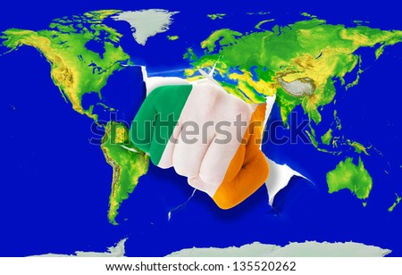 Fist in color national flag of ireland punching world map as symbol of export, economic growth, power and success - stock photo