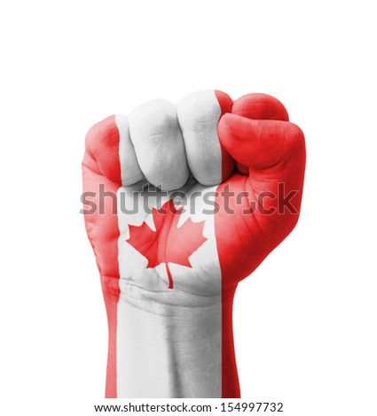 Fist of Canada flag painted, multi purpose concept - isolated on white background - stock photo