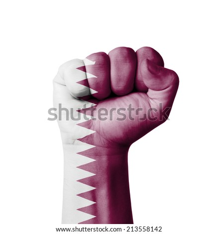 Fist of Qatar flag painted - stock photo