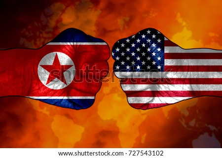 fist of us or usa or united state of america versus north korea flag in background
