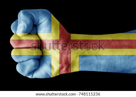 Fist painted in colors of Aland islands flag, fist flag, country of Aland islands